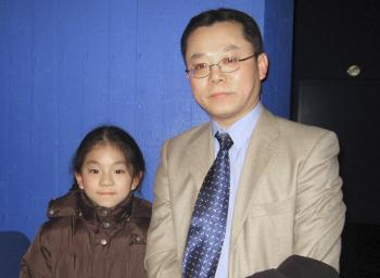 Mr. Wang brought his daughter to attend the second show of Shen Yun Performing Arts in Aarhus. (Lilly Wang/The Epoch Times)