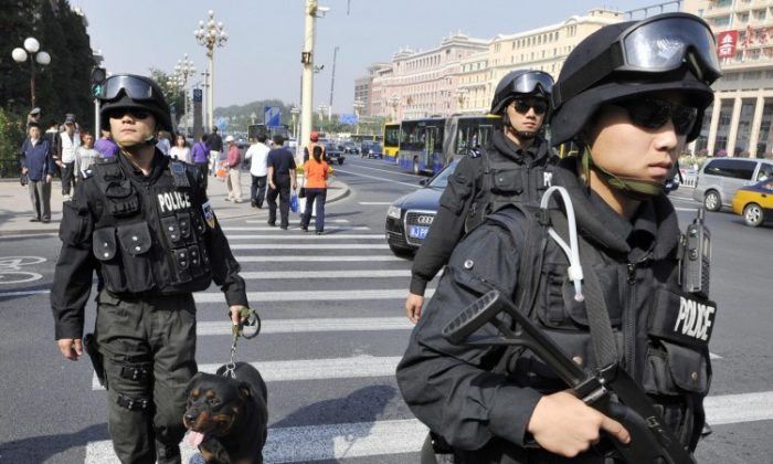 Armed Chinese police patrol a main street in downtown Beijing on Sept. 24, 2009. (STR/AFP/Getty Images)
