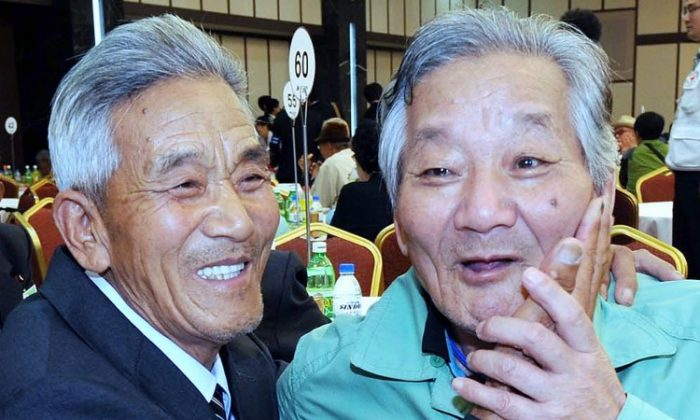 South Korean Lee Jung-Ho (R) reunites with his North Korean elder brother Lee Kwae-Seok (L) who joined the South Korean military and was taken prisoner by North Korea during the Korean War, on September 27, 2009 at the Mount Kumgang resort in North Korea. (Pool/Getty Images)