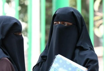 The niqab, a style of headwear that leaves only the eyes exposed, has reignited the debate over accommodating minorities in Quebec. (Cris Bouroncle/AFP/Getty Images