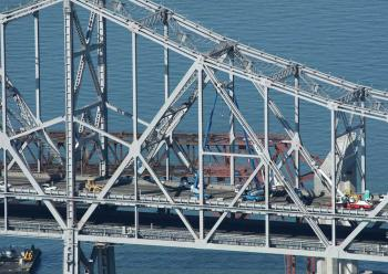 Workers continue to make emergency repairs to the eastern span of the San Francisco Bay Bridge. Repair work on the collapsed section will continue through the weekend. (Justin Sullivan/Getty Images)