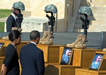 President Barack Obama and his wife Michelle view the Fallen Soldier Memorial at Fort Hood on November 10, 2009 during a ceremony honoring the 13 people killed in a shooting rampage at the army base on November 5. (Paul J. Richards/AFP/Getty Images)