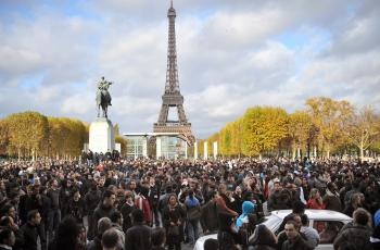 MISSED MONEY: People gather near the Eiffel Tower, waiting for French marketing company Mailorama hostesses to deliver envelopes of cash (a total of 5,000 envelopes containing between 5 to 500 euros each), on November 14, in Paris, as part of a French mar (Lionel Bonaventure/AFP/Getty Images)