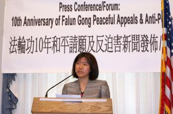 Shuangying Zhang, US citizen and resident of New York City, spoke of the recent long sentence of her 68-year-old father, Xingwu Zhang, who practices Falun Gong in China. She spoke in Washington on Capitol Hill, April 30. (Lisa Fan/The Epoch Times)