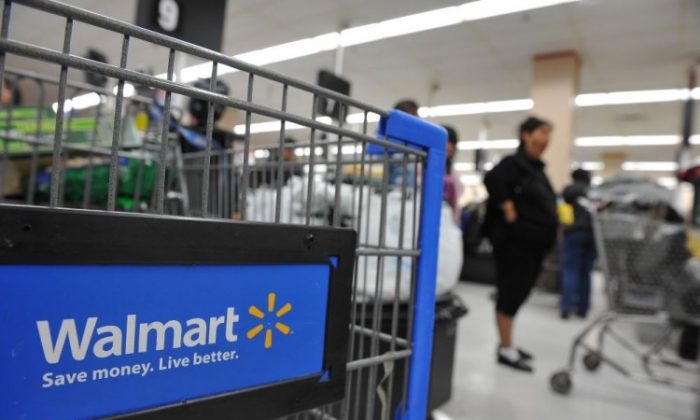 Shoppers wait in line to pay for their purchases at a Walmart store in Los Angeles. (Robyn Beck/AFP/Getty Images)