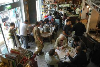 Israeli and foreigners eat at a busy 'MahneYuda', a recently opened gourmet non-Kosher restaurant, in Jerusalem's landmark Mahne Yehuda market. (Marina Passos /Getty Images)