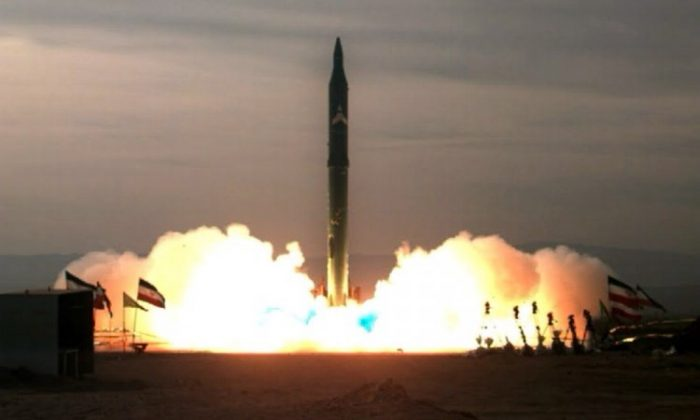 Photo from Iranian ISNA news agency on Dec. 16, 2009, shows the test-firing at an undisclosed location in Iran of an improved Sejil 2 medium-range missile, which Tehran says can reach targets inside Israel. (Vahi Reza Alaee/AFP/Getty Images)