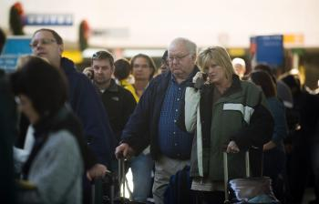 Heightened security caused long waits and missed flights at airports in Canada and the United States after a Nigerian man attempted a terrorist attack on a Northwest Airlines flight on Christmas Day in Detroit.  (Jim Watson/AFP/Getty Images)