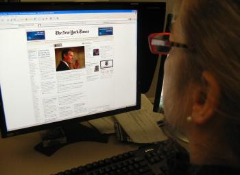 A woman reads the online version of the New York Times on January 20, 2010. The New York Times announced Wednesday that it will begin charging online readers of the newspaper at the beginning of next year. 'The new approach, referred to as the metered mod (Karen Bleier/Getty Images)