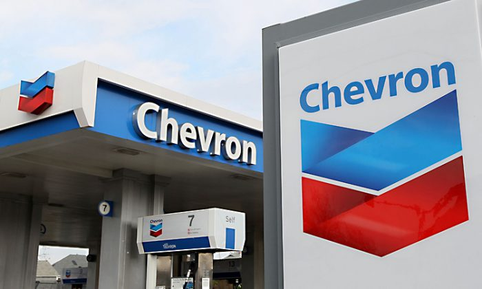 The Chevron logo is displayed at a Chevron gas station located in Alameda, Calif. in this file photo. Chevron produces 2.76 million barrels of oil a day and is considered the second largest oil company in the United States, according to Morningstar Inc. (Justin Sullivan/Getty Images)