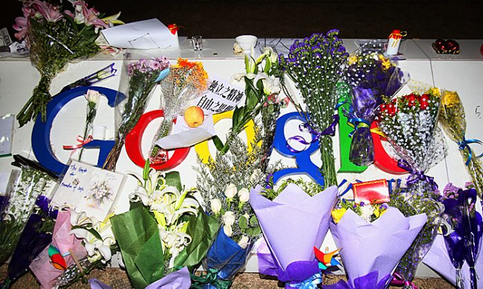 A card, a letter and flowers are placed on the Google logo at its China headquarters building in Beijing, China, on March 23, 2010, the day Google announced its intention to close its Chinese-language search engine in mainland China. A new report documents how Zhou Yongkang and Bo Xilai conspired with the Chinese search engine Baidu to use the Internet to attack their opponents. The price Zhou and Bo were willing to pay: Get Google out of China. (Feng Li/Getty Images)
