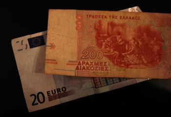 An old Greek drachma bill is seen on top of modern Euro. Greece continues to be the major source of woes for the European Union, as its debt crisis keeps spreading significant repercussions for the euro currency.  Last Friday, the euro hit its lowest poin (Chris Hondros/Getty Images)