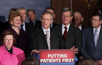 Flanked by Senate Democrats, Senate Majority Leader Harry Reid (D-NV) (C) speaks after a vote on health care on Capitol Hill on Mar. 25, 2010 in Washington, DC.  (Mark Wilson/Getty Images)