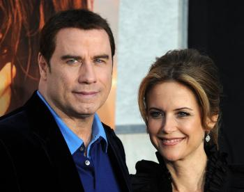 Actor John Travolta and his wife actress Kelly Preston arrive for the premiere of 'The last song' in Hollywood, California on March 25.  (Gabiel bouys/Getty Images)