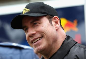 Actor John Travolta walks in the paddock before qualifying for the Australian Formula One Grand Prix at the Albert Park Circuit on Mar. 27, 2010 in Melbourne, Australia. (Ryan Pierse/Getty Images)