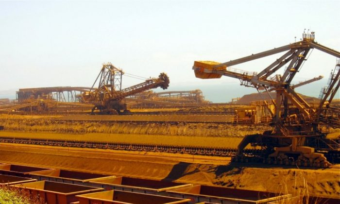 This photo taken in 2010 shows remote-controlled stackers and reclaimers moving iron ore to rail cars at Rio Tinto's Port Dampier operations in Western Australia's Pilbara region. (Amy Coopes/AFP/Getty Images)
