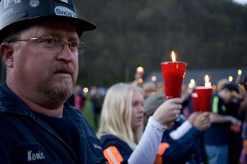 Coal miner Kevin Honaker participates in a candle light vigil for the explosion that killed 29 coal miners in April.  Miners will rally on Tuesday against Massey Energy for what they say is the company's negligence of safety standards for its workers.  (Kayana Szymczak/Getty Images)