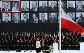 Archbishop Jozef Kowalczyk (C, R) conducts a mass during a public memorial service on Pilsudski square in Warsaw on April 17, 2010 for the 96 victims of last April 10's air crash in Smolensk that killed Poland's president Lech Kaczynski.   (Radek Pietruszka/Getty Images )