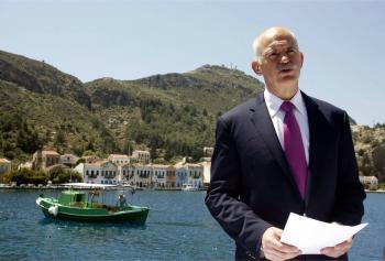Greek Prime Minister George Papandreou speaks to the media on the island of Kastelorizo, southeastern Greece on April 23. (Tatiana Bolari/AFP/Getty Images)