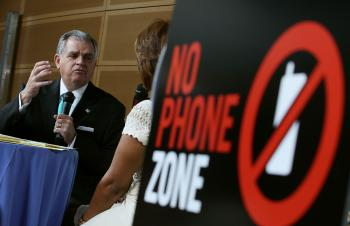 Transportation Secretary Ray LaHood appears with talk show host Gayle King at the Newseum on April 30, in Washington, DC. The Oprah Winfrey Show is sponsoring a 'No Phone Zone' rally nationwide. (Mark Wilson/Getty Images)