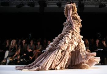 A model showcases a design by Aurelio Costarella on the catwalk on the first day of Rosemount Australian Fashion Week Spring/Summer 2010/11. (Ian Waldie/Getty Images)