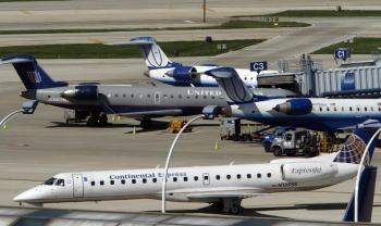 Continental and United Airlines jets taxi to and from the gate at a gate at O'Hare International Airport May 3, 2010 in Chicago, Illinois.  (Frank Polich/Getty Images)