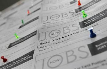 Job listings are posted on a bulletin board at the Career Link One Stop job center in San Francisco.  (Justin Sullivan/Getty Images)