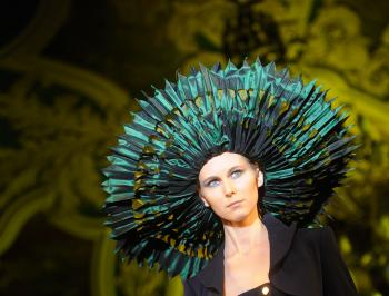 DRAMATIC HAT: This hat, featured during Jean Paul Gaultier's fashion show in Moscow, reminds one of the paper decorations children play with, yet it strikes a dramatic note. (Natalia Kolesnikova/AFP/Getty Images)