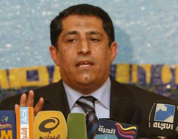 Qassim al-Abbudi, spokesman for Iraq's Independent High Electoral Commission (IHEC), speaks during a press conference in Baghdad on May 16. Iraqi Prime Minister Nuri al-Maliki failed to gain the four seats he needed to form a coalition government. (Ahmad Al-Rubaye/Getty Images )