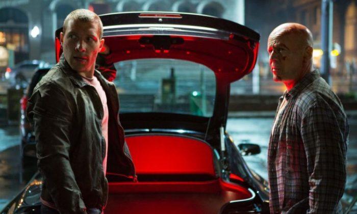 "Jack McClane (Jai Courtney) (L) and his dad John McClane (Bruce Willis) (R) prepare for battle in the action-thriller ""A Good Day to Die Hard."" (Frank Masi/Twentieth Century Fox Film Corporation)"