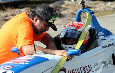 Johnson gets last-minute advice from his father prior to hitting the track. (Chris Jasurek/The Epoch Times)