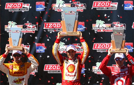 Ryan Hunter-Reay, Helio Castroneves, and Scott Dixon display their trophies after the IndyCar St. Pete Grand Prix. (James Fish/The Epoch Times)