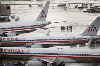 American Airlines parent company AMR Corp. has sued travel bookings website Orbitz Worldwide and its booking distribution company, in the latest development in an increasingly acrimonies row between airlines and travel booking sites. (Joe Raedle/Getty Images )