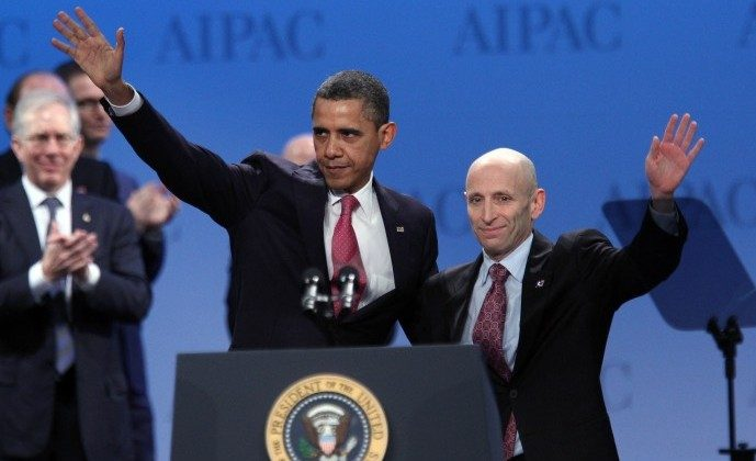 President Barack Obama waves with Lee Rosenberg, president of the American Israel Public Affairs Committee (AIPAC) after speaking at their annual conference in Washington, D.C., March 4. Obama reaffirmed his strong backing for key ally Israel, warning Iran that he would not hesitate to use force, if required, to stop it developing a nuclear weapon. (CHRIS KLEPONIS/AFP/Getty Images)