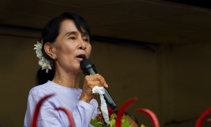 Democracy leader Aung San Suu Kyi speaks after winning her seat in the parliamentary elections April 2 in Yangon, Burma. (Paula Bronstein/Getty Images)