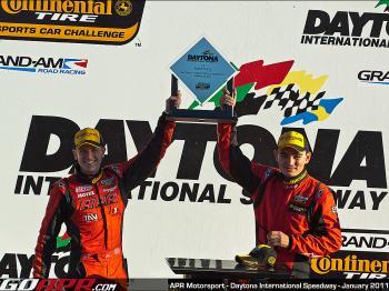 Ian Baas and Ryan Ellis celebrate winning the Continental Tire Sports Car Challenge Grand Am 200 at Daytona International Speedway. (Courtesy APR Motorsports)