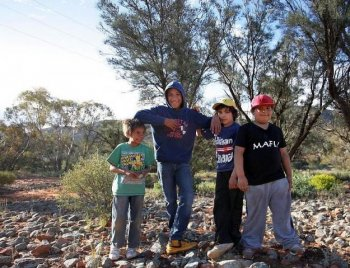TOUGH ODDS: File photo of Indigenous children of the Iga Warta community in the South Australian Outback. According to Australian statistics, only one of these four boys will survive to the age of 65. By all development indicators, indigenous Australians are one of the poorest communities in the world. (Lisa Maree Williams/Getty Images)
