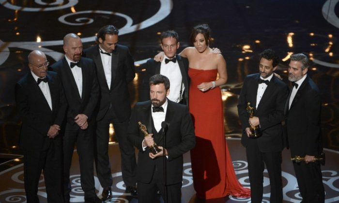 """Actor/producer/director Ben Affleck accepts the best picture award for """"""""Argo"""""""" onstage along with members of the cast and crew during the Oscars held at the Dolby Theatre on Feb. 24, 2013 in Hollywood, California. Making a Hollywood production about a true event that had much impact on U.S.-Iran relations while remaining accurate was a challenge for filmmakers. (Kevin Winter/Getty Images)"""