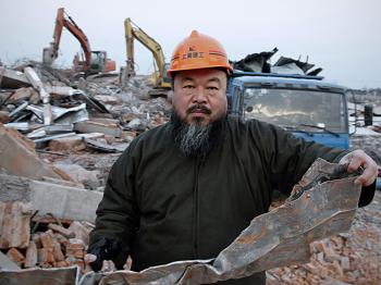 Chinese artist Ai Weiwei, 53, holds a piece of debris on January 11 after his newly built Shanghai studio was demolished. Ai is one of China's most famous, and defiant artists. He was arrested by authorities at Beijing Airport on Sunday and his whereabouts are unknown. (STR/AFP/Getty Images)