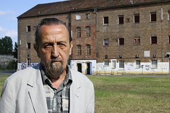 Raimund Anjust, in front of a Cottbus penitentiary building.  (Erick Rush/The Epoch Times)