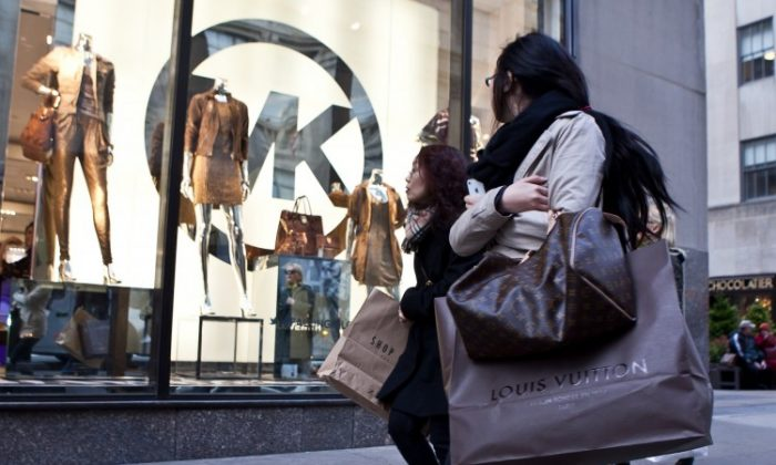 Shoppers in New York City, on Fifth Avenue near Rockefeller Center. Consumer spending is continuing a positive trend according to recent reports (Amal Chen/The Epoch Times)