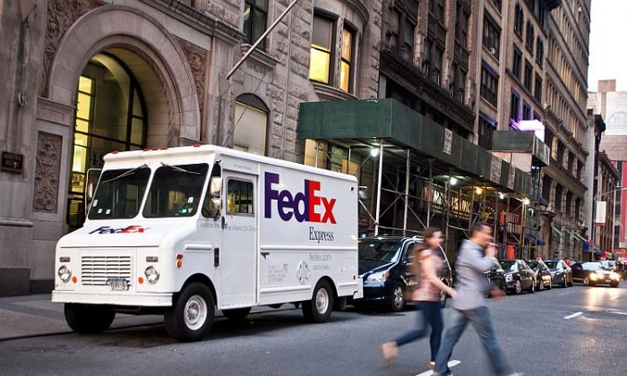 A FedEx truck is seen in Midtown Manhattan on Thursday, the day the shipping and logistics giant announced a 126 percent increase in fiscal third-quarter earnings. (Amal Chen/THE EPOCH TIMES)
