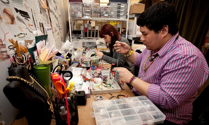 Designer Ciege Cagalawan and intern Adriana Ceka make bracelets for Shashi, located at 209 W. 38th St. (Amal Chen/The Epoch Times)