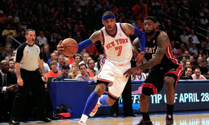Carmelo Anthony (L) outscored LeBron James (R) 42–29 but LeBron's Heat won 93–85. (Chris Trotman/Getty Images)