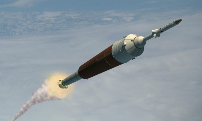 Artist's concept of NASA's Ares I crew launch vehicle. New research suggests that traveling faster than light-speed through space could annihilate your destination. (NASA)