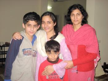 Arfa Randhawa's family: her brother, Sarmad, Arfa (center), her mother, Samina Amjad, and her brother, Dawood. Mr. Randhawa was at work at the time of the interview. (Masooma Haq/The Epoch Times)