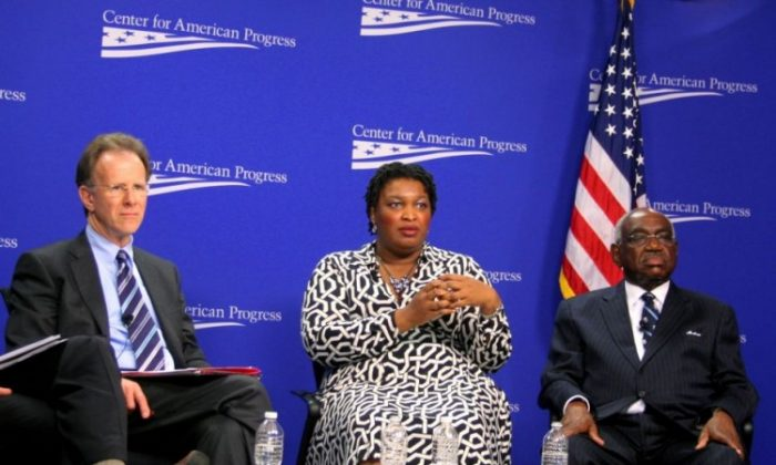 (L to R) Lucas Guttentag, lecturer in law at Yale Law School and lecturer at Stanford Law School; State Rep. Stacey Abrams (D-Ga.), House Minority Leader in the Georgia General Assembly; and Judge U.W. Clemon, retired federal judge from the Northern District of Alabama, agree that Arizona's immigration law S.B. 1070 promotes racial and ethnic profiling. The panel spoke April 4 at the Center for American Progress. (Gary Feuerberg/ The Epoch Times)