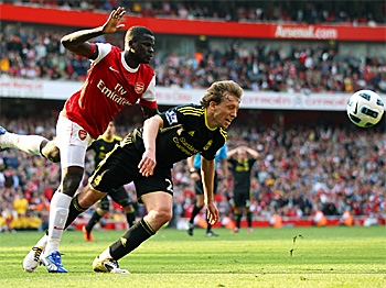 PENALIZED: Arsenal's Ivorian midfielder Emmanuel Eboue (L) collides with Liverpool's Brazilian player Lucas Leiva (2nd L) to concede a last-minute penalty during the Premiership football match at the Emirates. (Adrian Dennis/AFP/Getty Images)