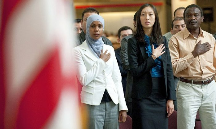 An Asian woman is among a group of newly naturalized U.S. citizens taking their Oath of Allegiance as part of a Constitution and Citizenship Day Naturalization Ceremony in this file photo. The Asian-American community was the fastest-growing in the United States over the last decade, and a driver of the small-business economy. (Jim Watson/AFP/Getty Images)