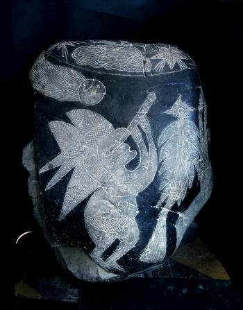 OBSERVING A COMET: This Ica Stone depicts a person wearing a headdress, observing a comet through a telescope.  (Courtesy of Eugenia Cabrera/Museo Cabrera)